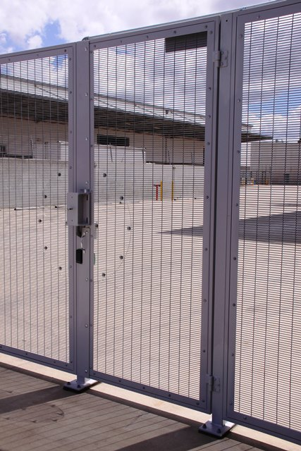 external barrier fence with pedestrian access