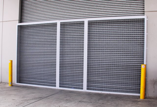 fixed security mesh panel fitted to roller shutter for security and ventilation